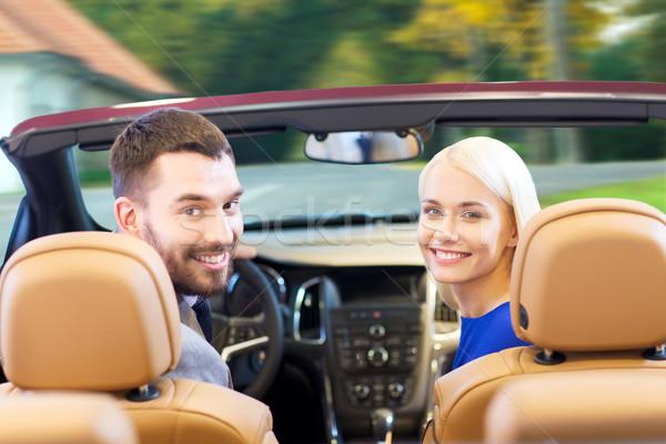 Feliz casal condução cabriolé carro cidade Foto stock © dolgachov
