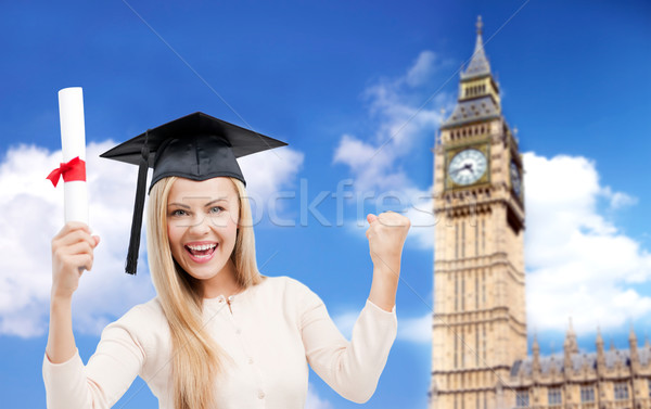 student in trencher cap with diploma over big ben Stock photo © dolgachov