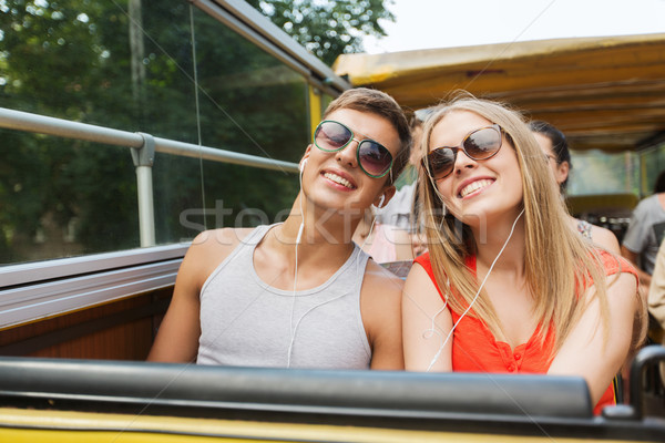 happy teenage couple traveling by tour bus Stock photo © dolgachov