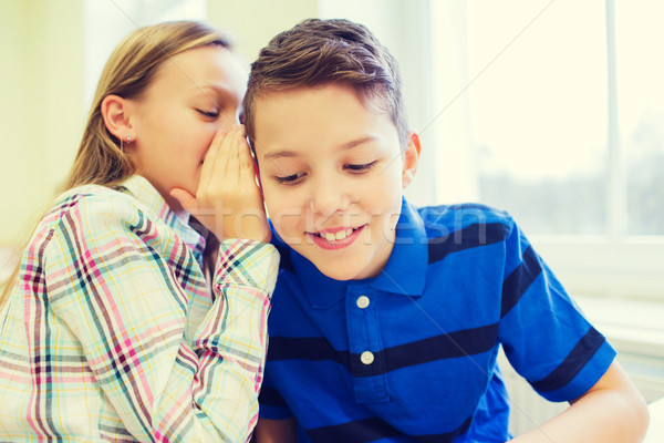 smiling schoolgirl whispering to classmate ear Stock photo © dolgachov