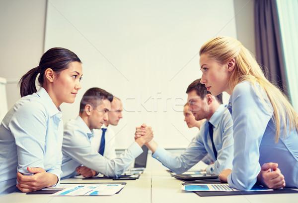 Sorridente pessoas de negócios conflito escritório crise confronto Foto stock © dolgachov