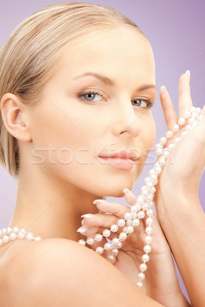 Bela mulher pérola colar violeta beleza luxo Foto stock © dolgachov