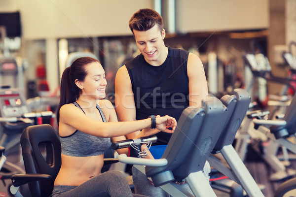 Szczęśliwy kobieta trener wykonywania rowerów siłowni Zdjęcia stock © dolgachov