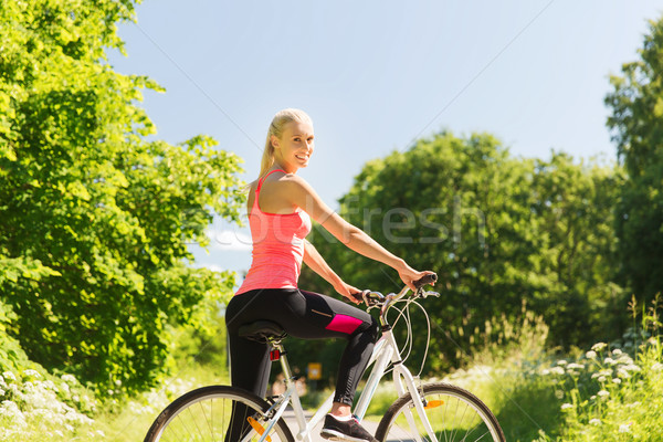 happy young woman riding bicycle outdoors Stock photo © dolgachov