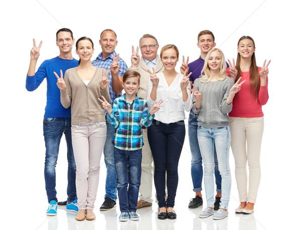 группа улыбаясь люди мира рукой знак Сток-фото © dolgachov