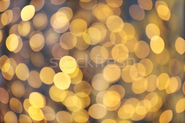 Elmosódott arany fények bokeh karácsony ünnepek Stock fotó © dolgachov