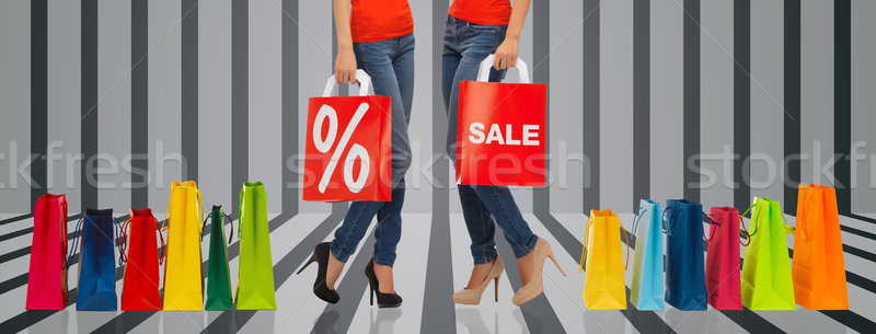 close up of women with sale sign on shopping bag Stock photo © dolgachov