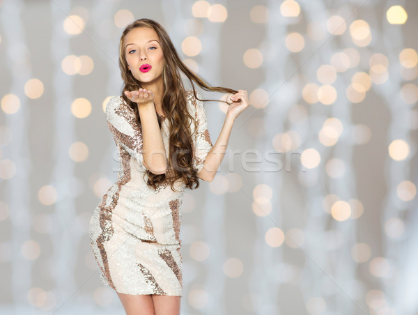 Stock photo: happy young woman or teen in dress over lights