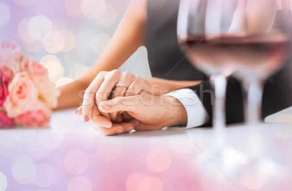 engaged couple holding hands Stock photo © dolgachov