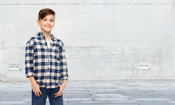 smiling boy in checkered shirt and jeans Stock photo © dolgachov