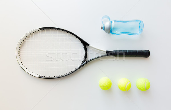 close up of tennis racket with balls and bottle Stock photo © dolgachov