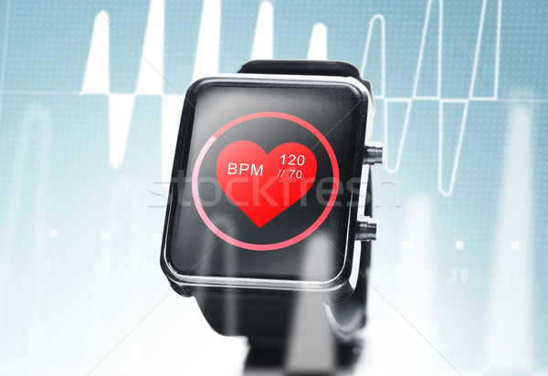 close up of black smart watch with heart beat icon Stock photo © dolgachov