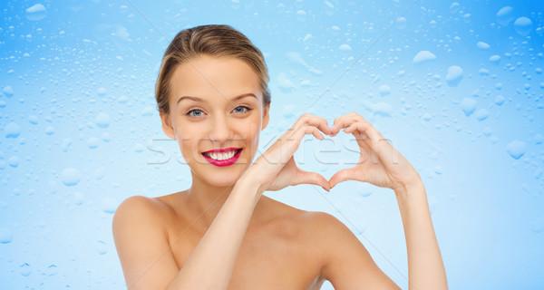 笑みを浮かべて 若い女性 心臓の形態 印相 美 ストックフォト © dolgachov