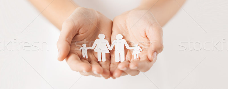 woman hands with paper man family Stock photo © dolgachov