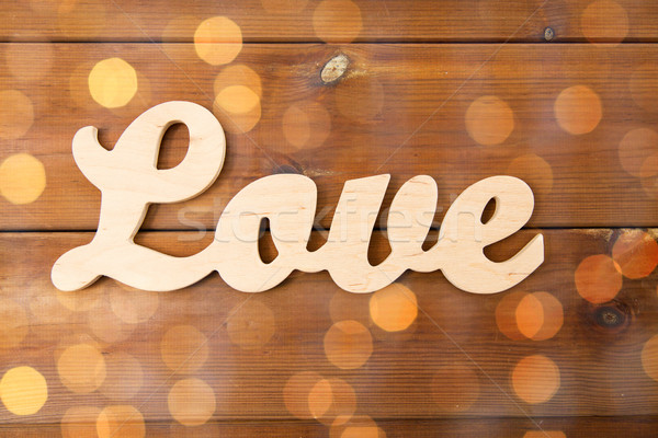 close up of word love cutout on wood Stock photo © dolgachov