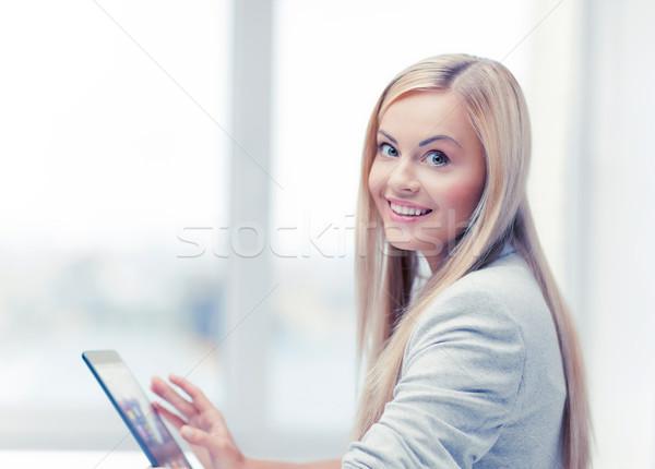 woman with tablet pc Stock photo © dolgachov