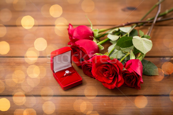 close up of diamond engagement ring and red roses Stock photo © dolgachov