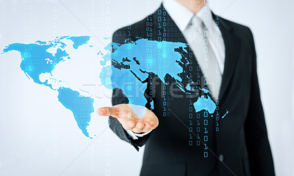 close up of man showing world map and binary code Stock photo © dolgachov