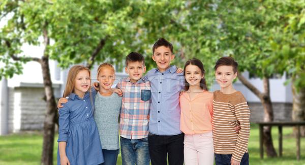 Boldog mosolyog gyerekek ölel udvar gyermekkor Stock fotó © dolgachov