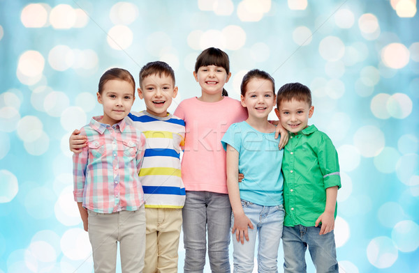 happy smiling little children hugging Stock photo © dolgachov