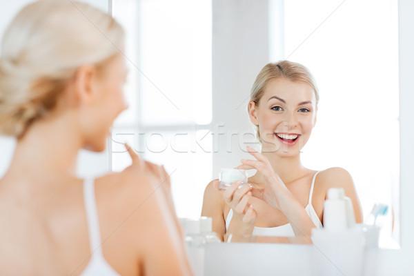 Feliz mulher creme cara banheiro Foto stock © dolgachov