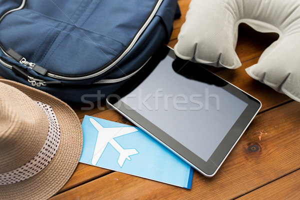 close up of tablet pc and traveler personal stuff Stock photo © dolgachov