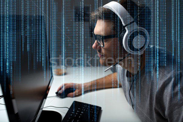 man in headset playing computer video game at home Stock photo © dolgachov