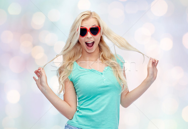 happy young woman in heart shape sunglasses Stock photo © dolgachov