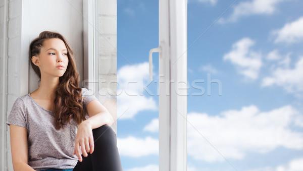 üzücü güzel genç kız oturma pencere eşiği insanlar Stok fotoğraf © dolgachov