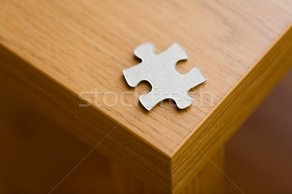 close up of puzzle piece on wooden surface Stock photo © dolgachov