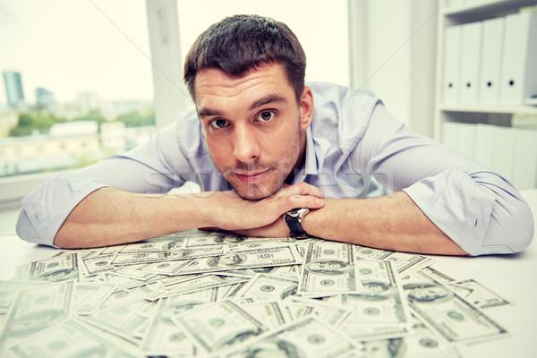 Heureux affaires tas argent bureau gens d'affaires Photo stock © dolgachov