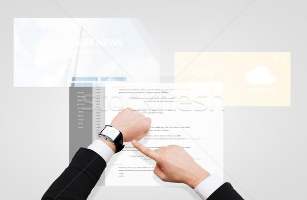 Empresario manos codificación inteligentes ver gente de negocios Foto stock © dolgachov