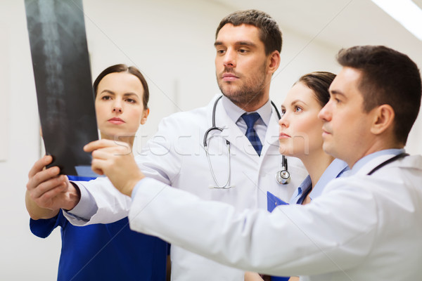 group of medics with spine x-ray scan at hospital Stock photo © dolgachov