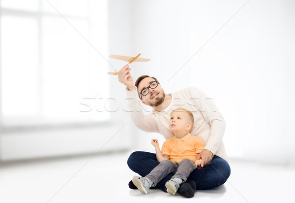 father and little son playing with toy airplane Stock photo © dolgachov