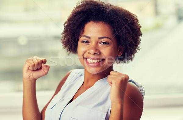 Boldog afrikai fiatal nő kiemelt emberek érzelmek Stock fotó © dolgachov