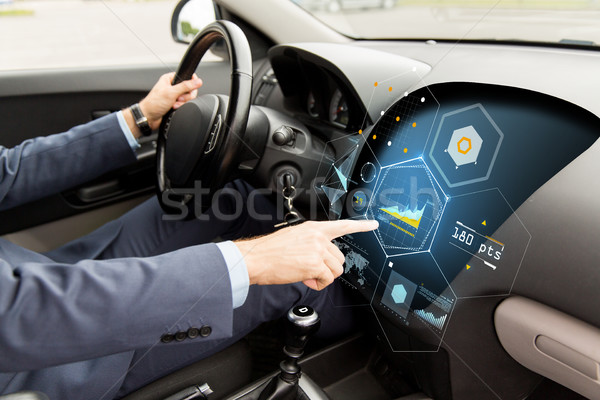 close up of man driving car with diagram on screen Stock photo © dolgachov
