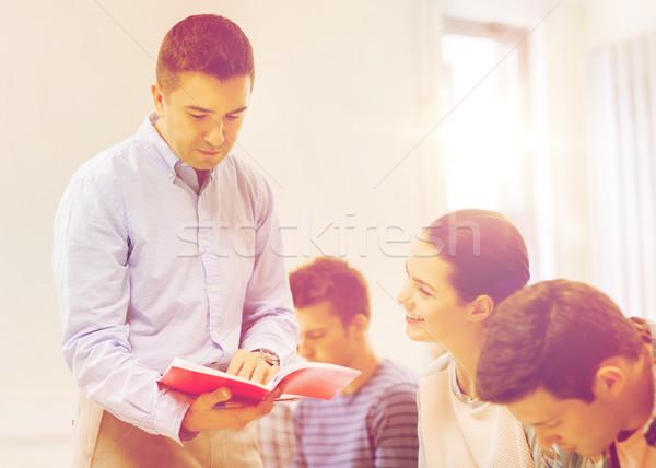 Grupy studentów nauczyciel notebooka edukacji liceum Zdjęcia stock © dolgachov