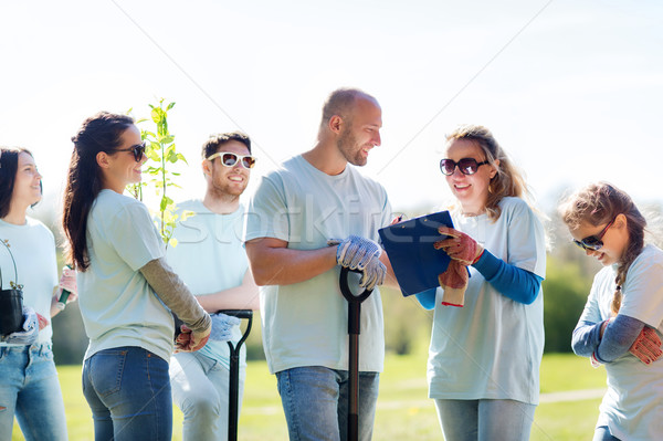 Stock photo: group of volunteers planting trees in park