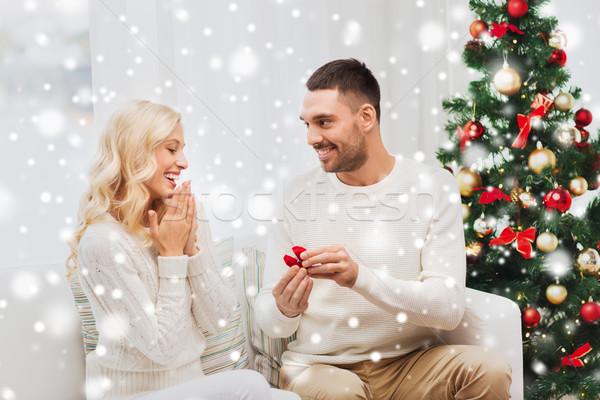 Homem mulher anel de noivado natal amor casal Foto stock © dolgachov