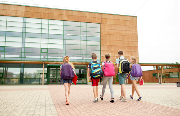 group of happy elementary school students walking Stock photo © dolgachov