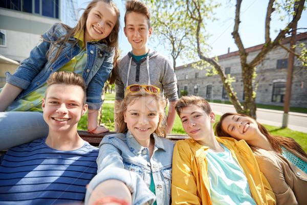 happy teenage students or friends taking selfie Stock photo © dolgachov