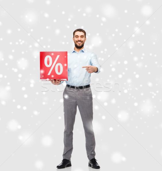 Lächelnd Mann rot Prozentsatz Zeichen Schnee Stock foto © dolgachov