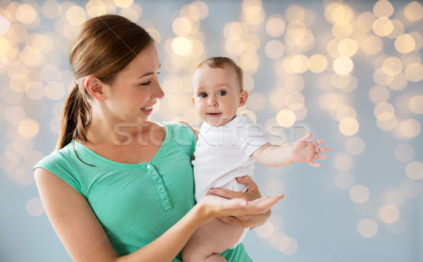 happy young mother with little baby Stock photo © dolgachov