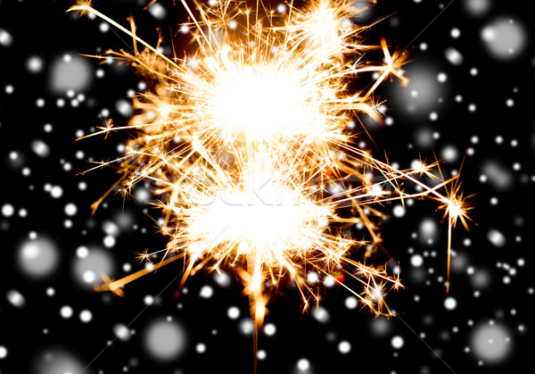 sparkler or bengal light burning over black Stock photo © dolgachov
