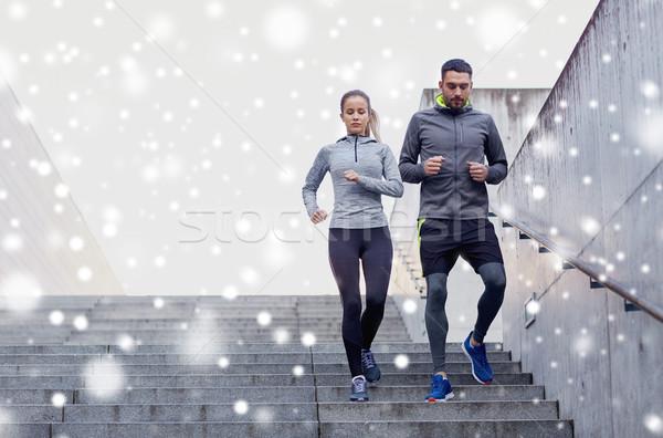 couple of sportsmen walking downstairs Stock photo © dolgachov