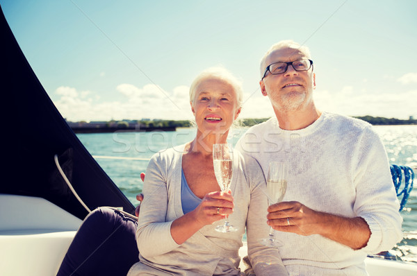 Couple de personnes âgées verres voile bateau yacht voile Photo stock © dolgachov