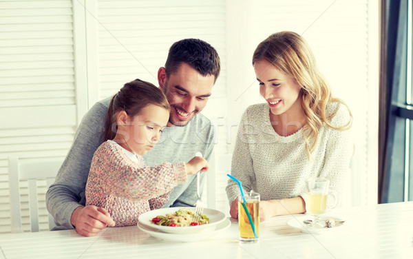 happy family having dinner at restaurant or cafe Stock photo © dolgachov