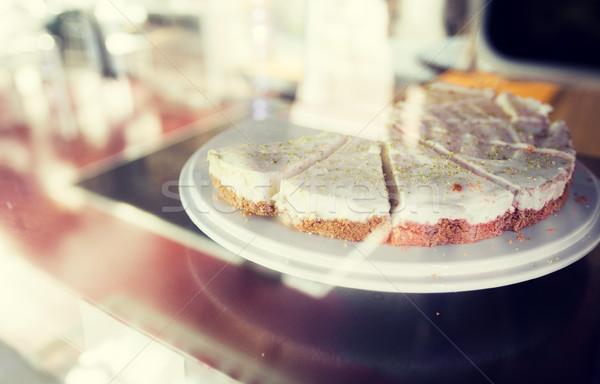 close up of cake on stand in cafe showcase Stock photo © dolgachov