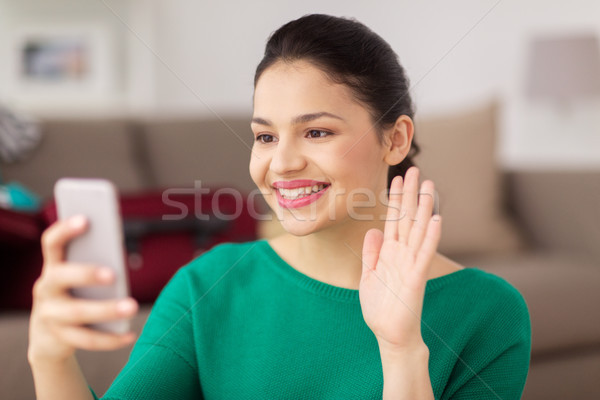 woman with smartphone taking selfie or video call Stock photo © dolgachov
