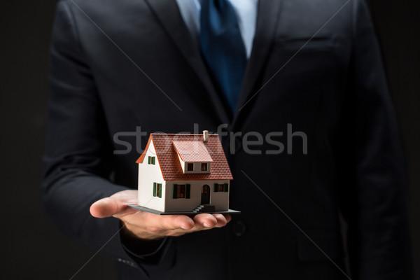 close up of businessman holding house model Stock photo © dolgachov